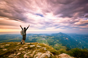 Hiker on top of the Mountain, Success Freedom Concept
